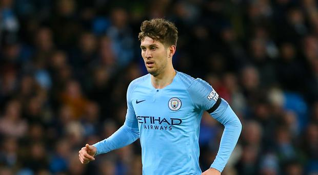 John Stones is aiming for four trophies (Richard Sellers/PA)