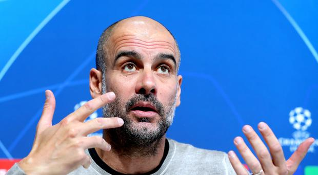 Pep Guardiola has issued a rallying cry to Manchester City fans (Martin Rickett/PA)