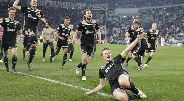 Ajax captain Matthijs de Ligt and teammates celebrate at the end of their Champions League quarter-final victory against Juventus (Luca Bruno/AP)