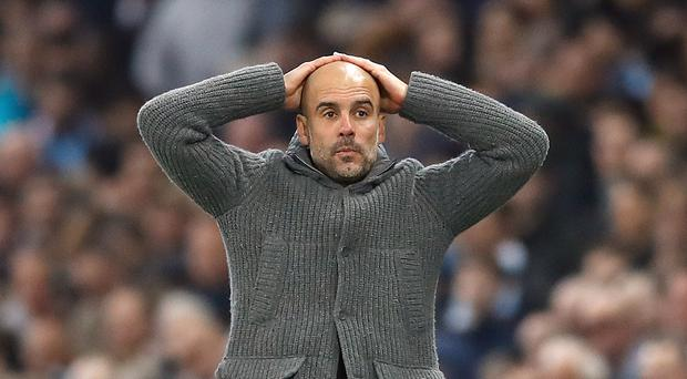 Pep Guardiola reacts after Raheem Sterling's goal is ruled out (Martin Rickett/PA)