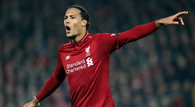 Liverpool's Virgil van Dijk is relishing his Champions League battle with Barcelona and Lionel Messi (Richard Sellers/PA)
