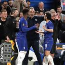 Chelsea manager Maurizio Sarri (centre) gives instructions to Callum Hudson-Odoi (left) as he is substituted on for Pedro during the UEFA Europa League quarter final second leg match at Stamford Bridge, London.