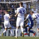 Wigan Athletic's Gavin Massey scores his teams second goal against Leeds United, during the Sky Bet Championship match at Elland Road, Leeds.