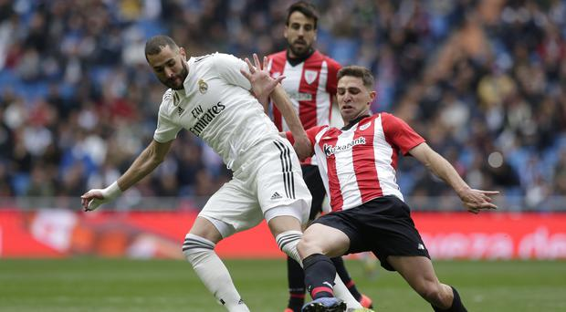 Real Madrid's Karim Benzema (left) scored a hat-trick against Athletic Bilbao (Bernat Armangue/AP/PA)