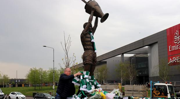 Tributes have been left at the statue of Billy McNeill (Lucy Christie/PA)