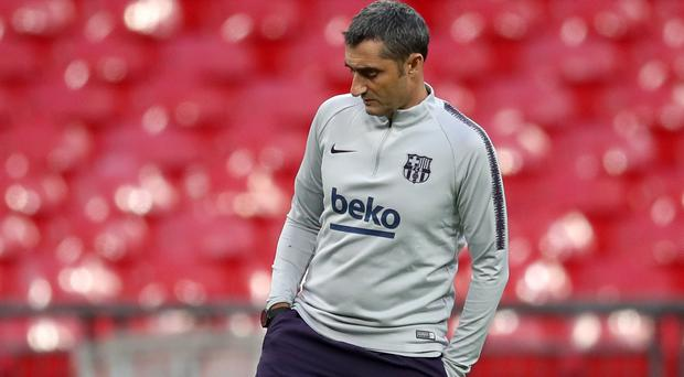 Barcelona coach Ernesto Valverde does not expect to have the LaLiga title handed to him by Atletico Madrid (Adam Davy/PA)