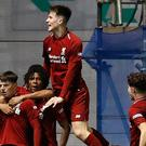 Liverpool's Bobby Duncan (left) celebrates scoring his side's first goal of the game during the FA Youth Cup final at The City Academy Stadium, Manchester.