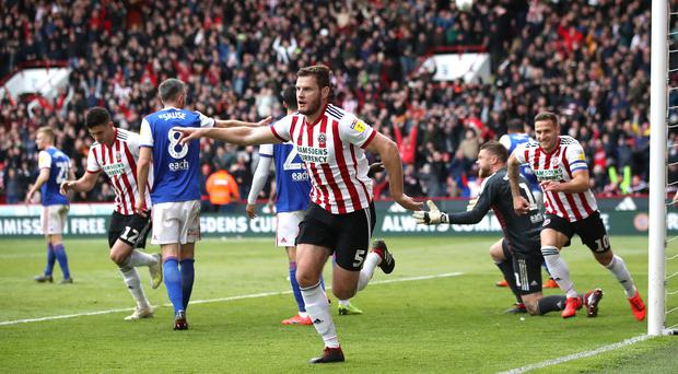 Sheffield United's Jack O'Connell (centre) celebrates scoring his side's second goal of the game during the Sky Bet Championship match at Bramall Lane, Sheffield.