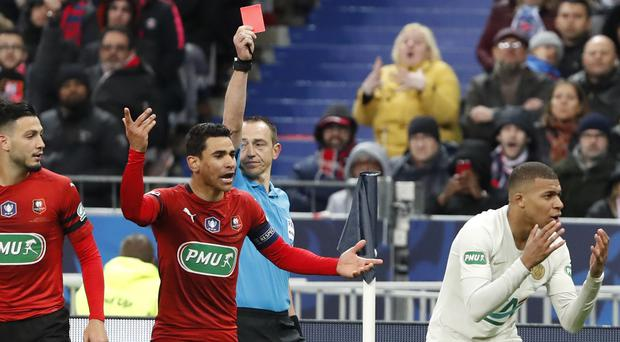 Kylian Mbappe, right, is shown the red card by referee Ruddy Buquet (Thibault Camus/AP)