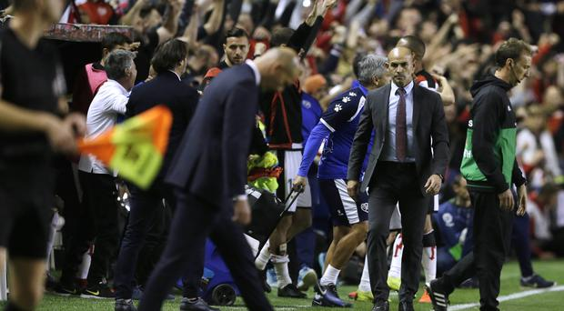 Real Madrid coach Zinedine Zidane walks off the pitch after his side's 1-0 defeat at Rayo Vallecano (Paul White/AP/PA)
