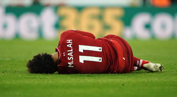 Mohamed Salah has been ruled out of the Barcelona clash with concussion (Owen Humphreys/PA)
