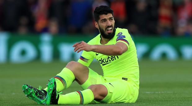 Barcelona's Luis Suarez had a mixed reception back at Anfield (Peter Byrne/PA)