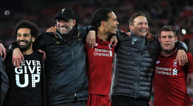Jurgen Klopp celebrates with Liverpool players after their 4-0 win against Barcelona at Anfield (Peter Byrne/PA)