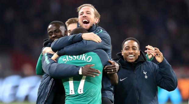 Harry Kane, centre, celebrates with his Tottenham team-mates after victory over Ajax (Adam Davy/PA)