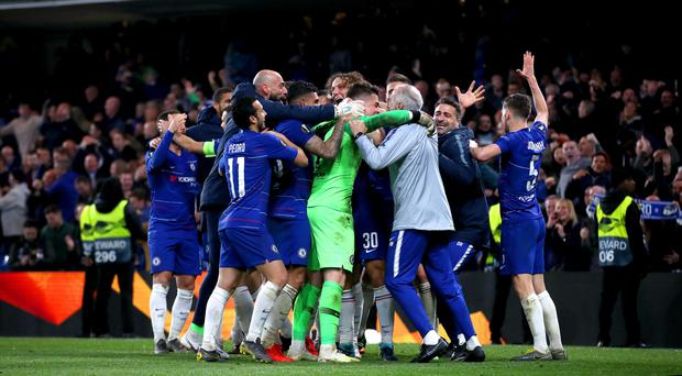 Chelsea players celebrate winning the penalty shoot-out (Tim Goode/PA)