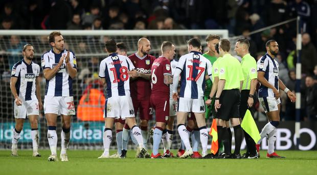Aston Villa players complain to referee Darren England after Jay Rodriguez's controversial goal (Adam Davy/PA)