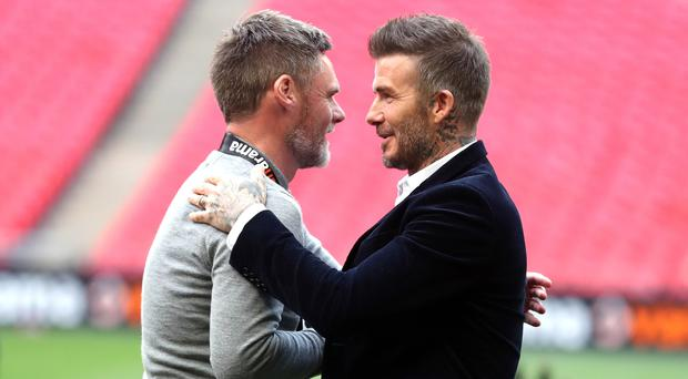 Salford City co-owner David Beckham (right) was at Wembley to see Graham Alexander's side win promotion (Bradley Collyer/PA)