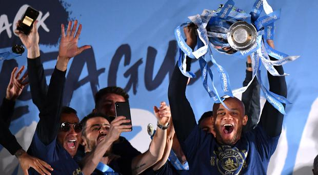 Vincent Kompany paraded the Premier League trophy at Manchester City's title party (Anthony Devlin/PA)