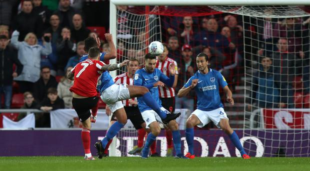 Chris Maguire (left) volleys Sunderland into a first-leg lead over play-off rivals Portsmouth. (Simon Cooper/PA)
