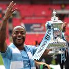 Manchester City's Raheem Sterling celebrates with the FA Cup (Nick Potts/PA)
