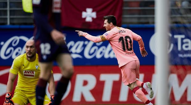 Lionel Messi struck twice in as many minutes against Eibar (Ion Alcoba/AP)