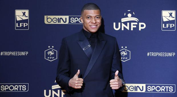 Kylian Mbappe celebrated his UNFP player of the year award with an eye-catching speech (Francois Mori/AP)