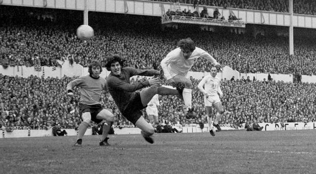Alan Mullery, right, scores for Spurs against Wolves in the 1972 UEFA Cup final (PA)
