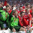 Peter Schmeichel (centre) lifted the Champions League trophy (Phil Noble/PA)