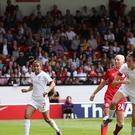Jill Scott (right) heads home England's second goal against Denmark (Barry Coombs/PA).