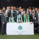 Neil Lennon and the Celtic squad pose with the trophies (Jeff Holmes/PA)
