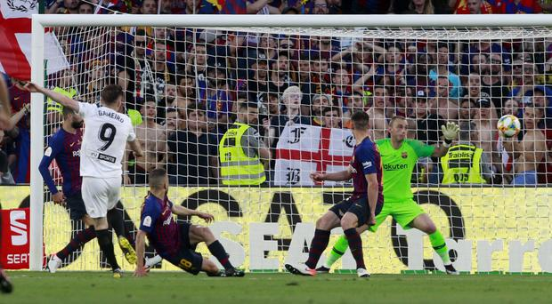 Kevin Gameiro (left) scored the important first goal as Valencia stunned Barcelona in the Copa del Rey final (Miguel Morenatti/AP)