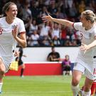 Jill Scott (left) was on target in the warm-up against Denmark (Barry Coombs/PA)