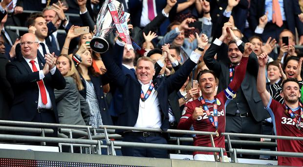 Aston Villa boss Dean Smith celebrates with the trophy after his team seal Premier League promotion via the play-offs (Mike Egerton/PA)