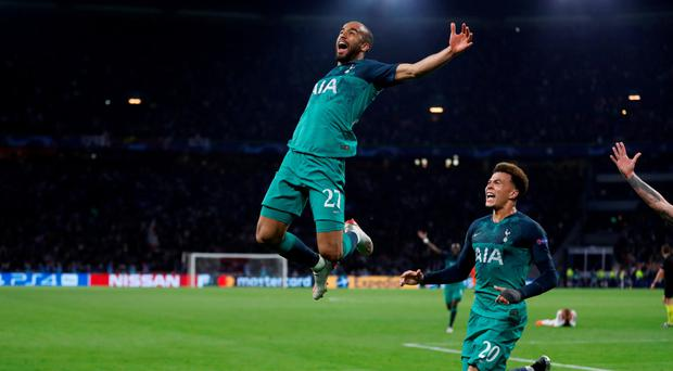 Flying high: Spurs ace Lucas Moura celebrates his last-gasp winner against Ajax in the Champions League semi-final alongside Dele Alli
