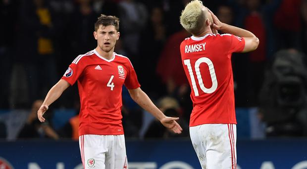 Ben Davies and Aaron Ramsey are missing for Wales (Joe Giddens/PA)