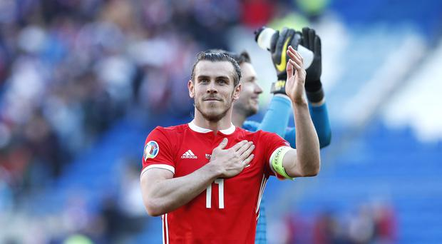 Gareth Bale's love for football remains as strong as ever, according to Wales manager Ryan Giggs (Darren Staples/PA)