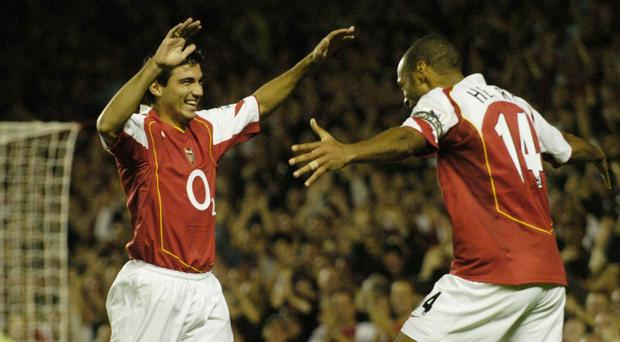Arsenal's Jose Antonio Reyes, left, celebrates his goal with Thierry Henry against Blackburn Rovers. (Rebecca Naden/PA)