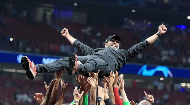 Liverpool manager Jurgen Klopp is thrown into the air by his players after winning the UEFA Champions League Final with Liverpool (Peter Byrne/PA)