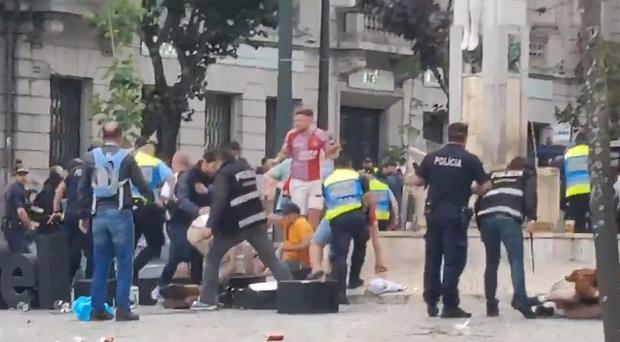 England fans clash with police in Porto (Screengrab/Matt Brown)