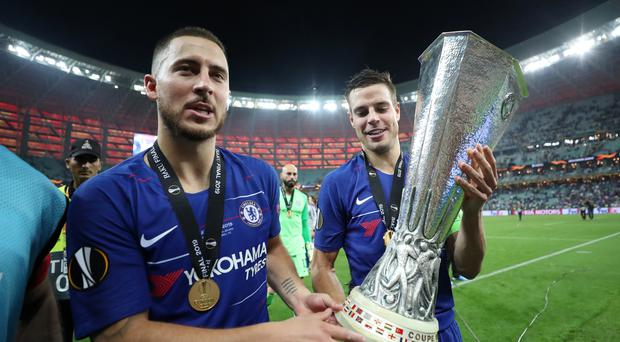 Eden Hazard, left, is closing in on his transfer to Real Madrid (Bradley Collyer/PA)