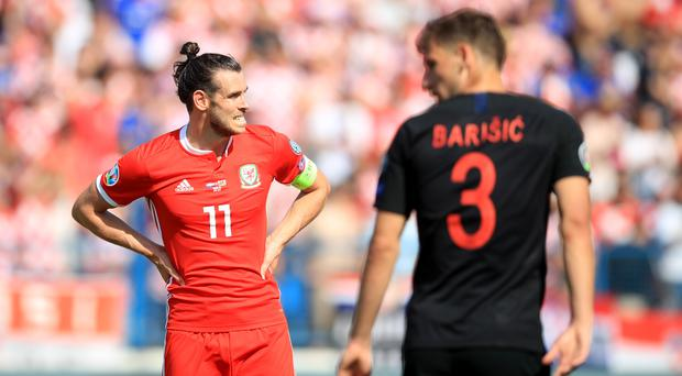 Gareth Bale (left) looks on anxiously as Wales suffer a 2-1 Euro 2020 qualifying defeat to Croatia in Osijek (Adam Davy/PA)