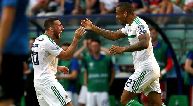 Conor Washington. left, and Josh Magennis celebrate after Northern Ireland's equaliser (Steven Paston/PA)