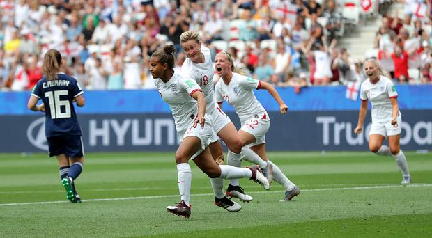 England's Nikita Parris celebrates opening the scoring from the penalty spot (Richard Sellers/PA).