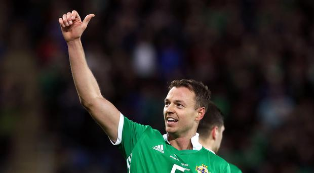 Jonny Evans and Northern Ireland are seeking a fourth straight win on Tuesday (Brian Lawless/PA)