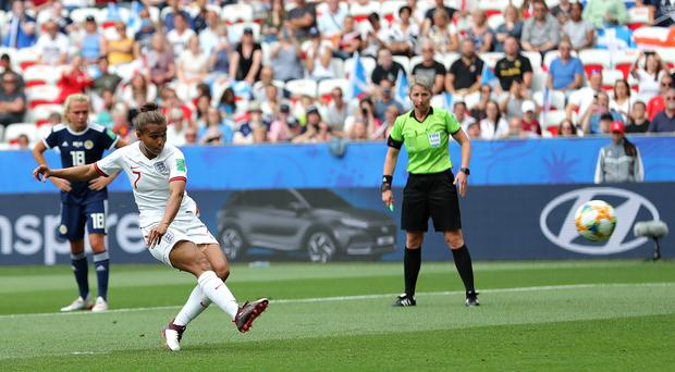 Nikita Parris opens the scoring from the penalty spot in England's win over Scotland (Richard Sellers/PA).