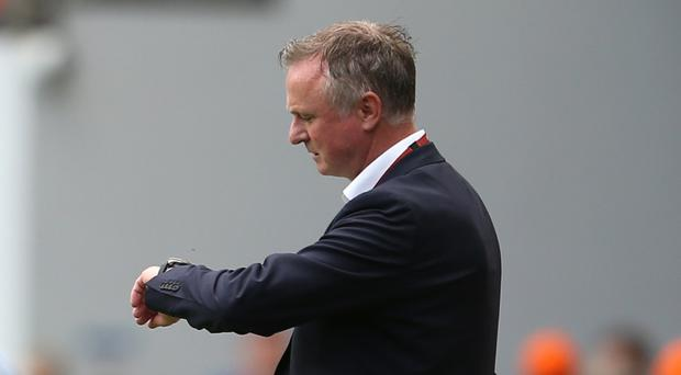 Michael O'Neill is hoping to put pressure on Holland with a fourth straight win on Tuesday (Steven Paston/PA)