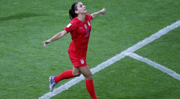 Alex Morgan celebrates one of her five goals in the United States' thrashing of Thailand (Francois Mori/AP).