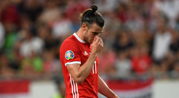 Gareth Bale cut a dejected figure during Wales' 1-0 Euro 2020 qualifying defeat to Hungary in Budapest (Joe Giddens/PA)