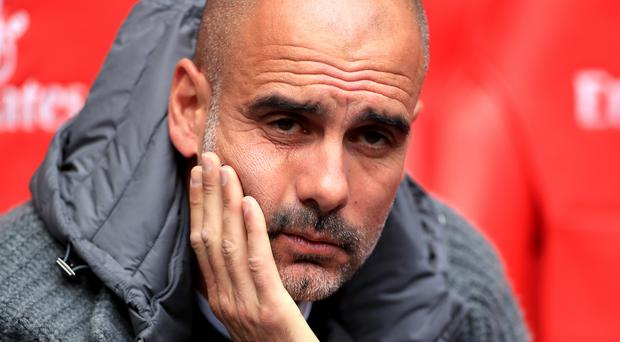 Manchester City manager Pep Guardiola is reportedly considering a sabbatical (Mike Egerton/PA)