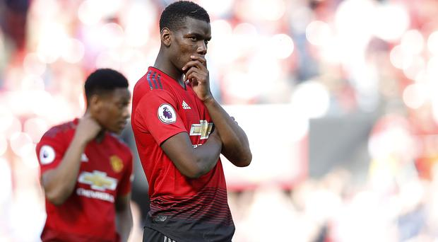 Paul Pogba is reportedly wanted by Real Madrid (Martin Rickett/PA)